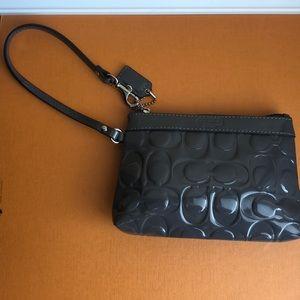 Gray patent leather coach wristlet